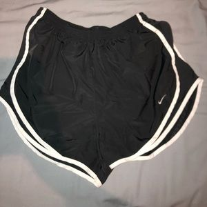 Dark gray and white dri-fit Nike athletic shorts
